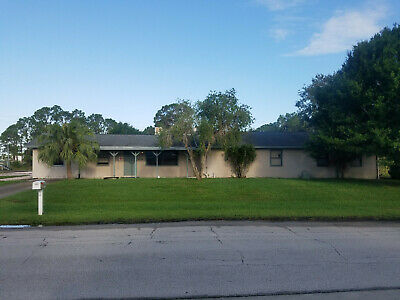 1.5 acre parcel with 3 buildings and pool