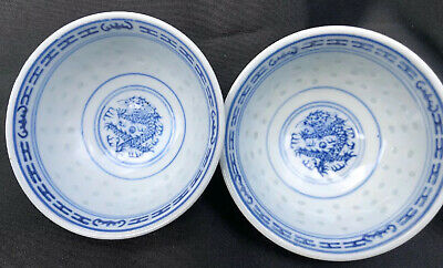 A pair of Dragon Chinese antique vintage Rice Eyes pattern Tea Bowls/ cups