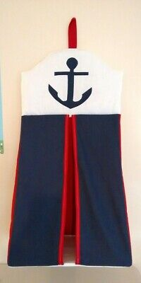 Baby nappy stacker in red, navy and white with a large anchor design.