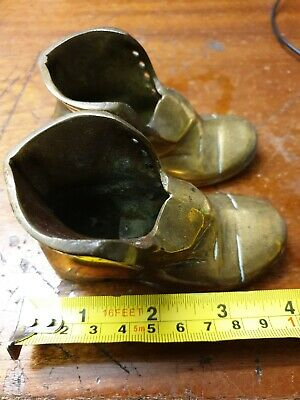 A Pair Of Vintage Solid Heavy Brass Boots