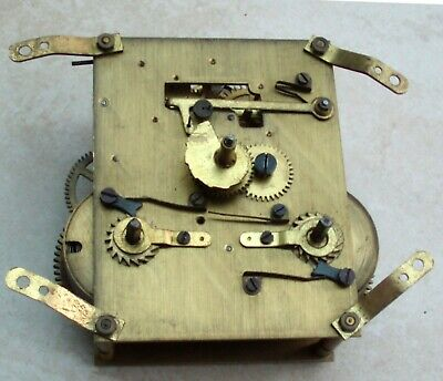 """""""Made in England"""" vintage striking clock movement for parts, spares or repair."""