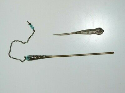 Two antique or vintage ornate tools