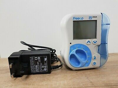 Abbott FreeGo pump - Abbott Nutrition Enteral Feeding Pump and power adapter