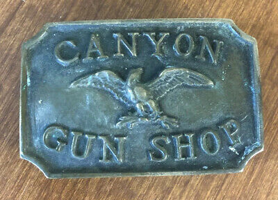 Vintage Solid Brass CANYON GUN SHOP Belt Buckle W/ American Eagle Advertising
