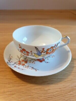 Hand-painted Klimax Japan thin porcelain cup and saucer, bird and flowers