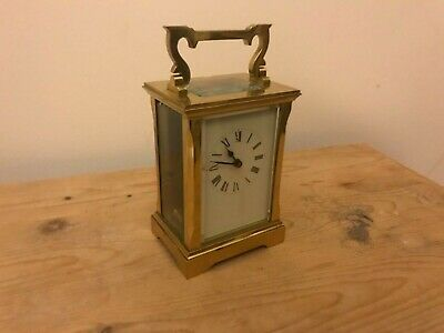 Antique ACG ( works on its side)  brass cased skeleton carriage clock