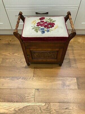 Antique vintage Piano stool with tapestry seat Trimmed in red velvet.