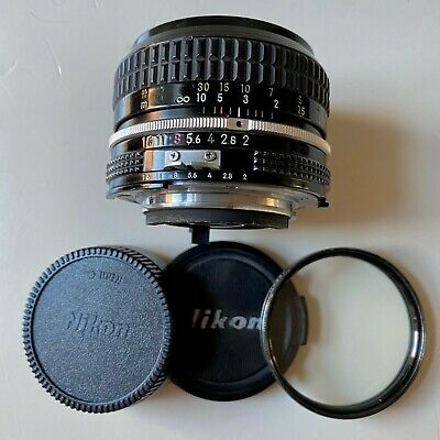 NEAR MINT. Nikon Nikkor 50mm f/2 ai lens w/caps + UV filter. FREE SHIP