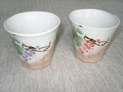 Two Japanese handcrafted pottery mugs one blue one red flower 8cm x 9cm