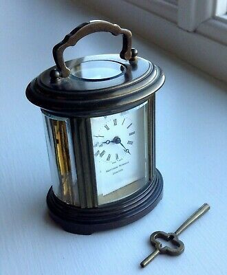 Miniature Oval Shaped Matthew Norman Carriage Clock 6.5cm High