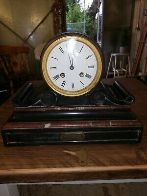Antique mantle clock working  and chimes, with key