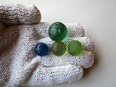 very rare ancient lot of 4 Roman glass game legionary knuckle gaming pieces.