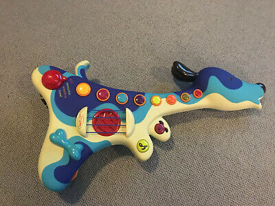 B. Toys Woofer Hound Dog Electronic Toy Guitar