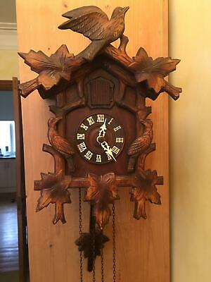 Antique black Forrest cuckoo clock fully working