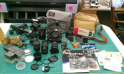 Canon A-1 Camera with Lenses, Flash & Accessories, Manuals, Filters, Camera Bags