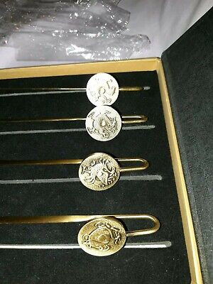 The 4 Japanese Dragons: Exquisite brass coin book marks. New, presentation box.