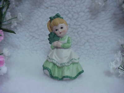 St. Patrick's Day Little Girl Figurine - Adorable Holding Clover In Her Hand -