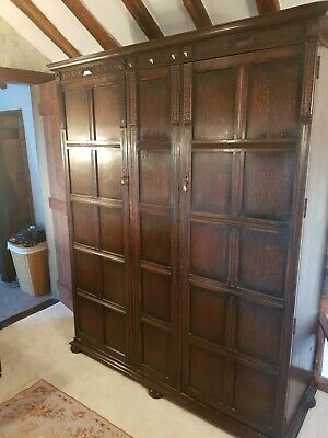 Large antique wardrobe with mirror and shelving, drawers and hanging rack