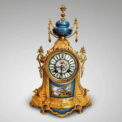 4786 A highly decorative French ormolu clock with porcelain panels FREE SHIPPING