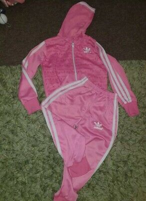 Girls pink tracksuit age 5.