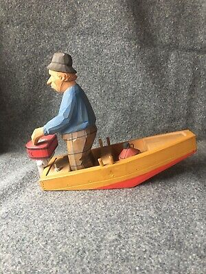 Lars Trygg Man In Boat Wood Carving