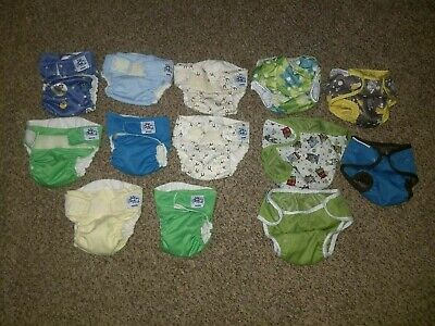large cloth diaper lot soft bums shells liners and wet bags complete set