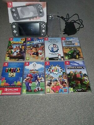 Nintendo switch lite console grey with 8 games
