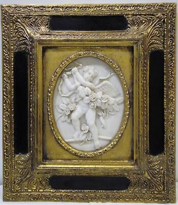 Antique  hand carved high relief oval alabaster plaque of a winged cherub