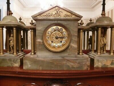 A 19th Century Onyx Mantle Clock With Garniture