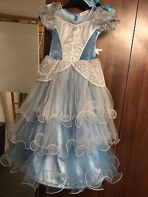 girls cinderella dress from Disney store . Age 7/8 years . Matching bow