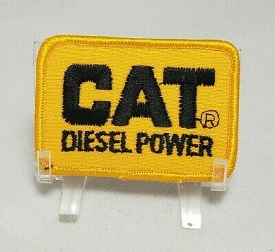 """Vintage New Old Stock Cat Diesel Power Embroidered Iron-On Patch 3"""" x 2"""" Yellow"""