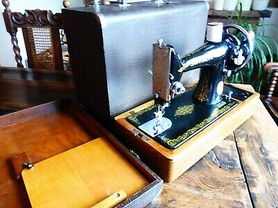 Early Singer Sewing Machine with Original fitted case and accesories No 99
