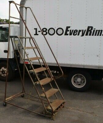 """Rolling Step Ladder - 7 Step - 24"""" wide - 66"""" tall at highest step"""