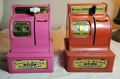 Two (2) Vintage Uncle Sam's 3 Coin Register Banks One Red Colored & One Pink