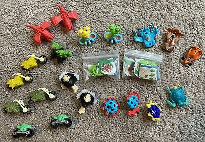Lot of 22 Magic Kinder Egg Surprise Toys with their paper insert