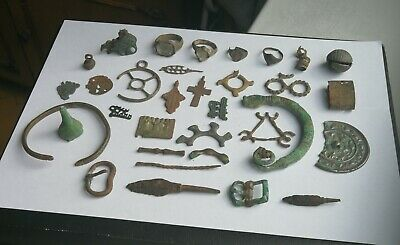 Ancient Viking . Whole and broken crosses , rings , buckles and amulets 5-15 AD