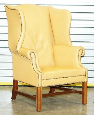 Circa 1900 Restored Large Wingback Armchair In Mustard Tan Leather Upholstery