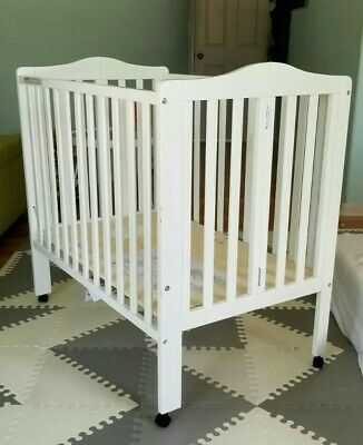 Foldable Mini Crib, Barely Used, Waterproof Mattress, Cover, Sheets Included