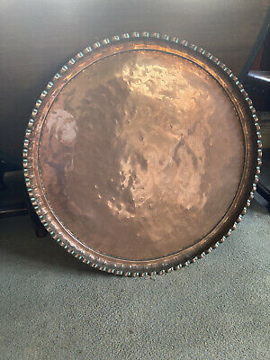 Large round antique copper tray.