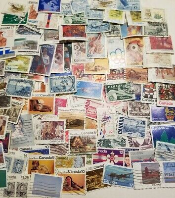 Canada 100 different stamps off paper large and small  #12