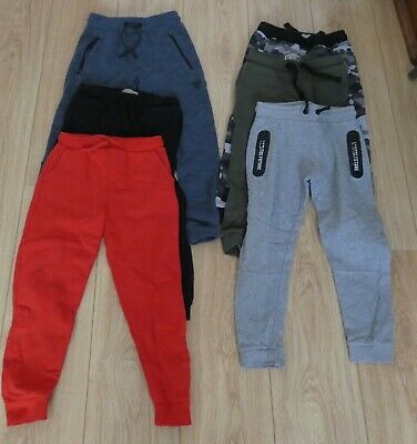 Boys bundle of 7 pairs tracksuit bottoms/skinny jeans age 6-7 - VGC