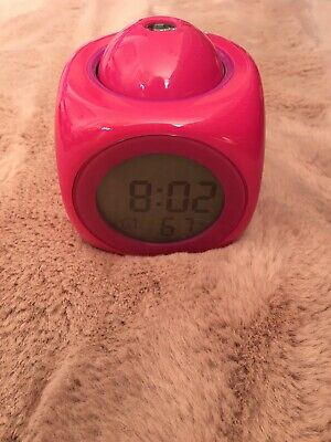 Pink Smiggle Clock With Illuminating Screen And Projects Onto The Ceiling