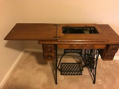 Antique Singer Sewing Machine In Treadle Cabinet