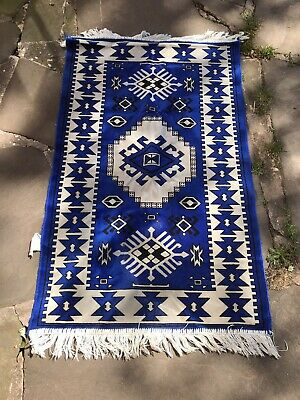 Small Blue And White Rug