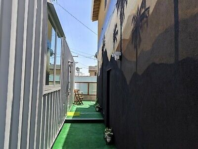 Shipping container home with separate bedroom, bathroom with open living/dining