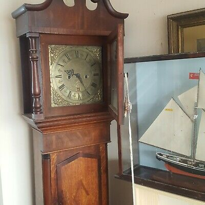 grandfather clock operating but requires a good clean,