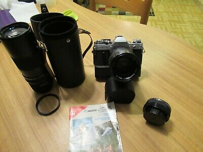 Canon AE-1 35 mm film cameras With Extras