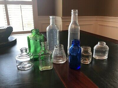 Lot of 9 Antique Old embossed glass and odd shaped glass bottles and containers