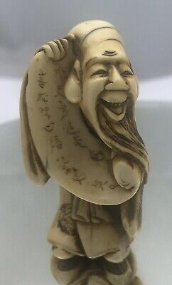 Fine antique 19th century Japanese Netsuke Man With Scroll Calligraphy
