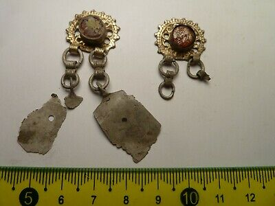 2861	A pair ancient Byzantine silver gilded earrings whit a red glass